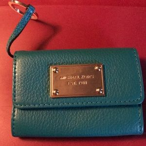 NWOT Micheal Kors flap wallet with key ring.